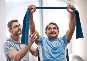 Rehabilitation therapist working with a patient